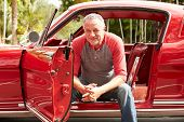 Retired Senior Man Sitting In Restored Classic Car