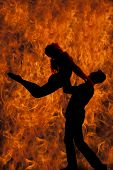 Silhouette Couple Dancing He Lifts Her Up Fire