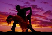 Silhouette Couple Dancing She Leans Back Touch Her Knee