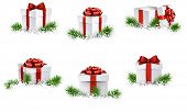 Collection of 3d christmas gift boxes with satin red bows. Realistic vector illustration.