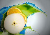Half of fresh orange and apple on white background