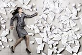 Attractive businesswoman running with papers in hand
