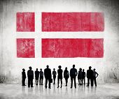 Silhouettes of Business People Looking at the Danish Flag
