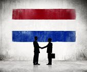 Silhouette of a Business Handshake with a Dutch Flag