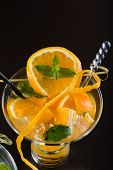 Fresh Orange and lime Mojito over black  background