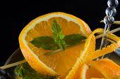 Fresh Orange Mojito over dark background