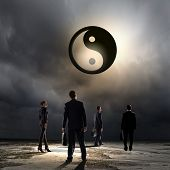 Group of businesspeople and yin yang sign