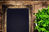 Salad Over Blackboard Wooden Background With Copyspace For Your Text.  Diet Food And Healthy Lifesty