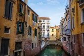 Narrow water canal in Venice, Italy