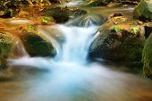 scene with nice cascade of mountain stream