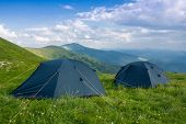 Two tourist tents in Carpathian mountains, Ukraine