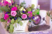 Flower Arrangement In A Basket Decorate The Wedding Table In Purple Tones. Vintage.