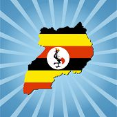 Uganda map flag on blue sunburst illustration