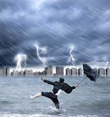 foto of scourge  - businessman holding an umbrella with thundershower background - JPG