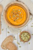 pumpkin soup with seeds closeup