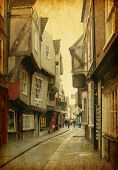 The Shambles, a medieval street in York, England, UK. Added Paper texture.