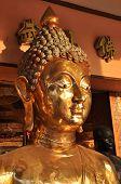 Cabeza de bronce de Buda cara flanco