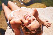 Young woman in bikini relaxing on resort