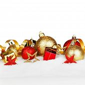 Christmas card with gold and red beautiful decorations in snow