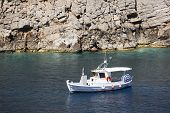 Boat In Sostis Bay. Cretan Beach. Mediterranean Sea. Greece