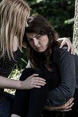 Woman Hugging Her Worried Friend