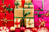 Three Heaps Of Christmas Gifts Sorted By Color