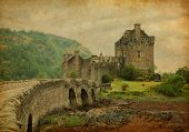 Eilean Donan castle in overcast spring day. low tide. Scotland, UK. Photo in retro style. Paper text