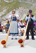 MOUNT PILATUS - JULY 13: Unidentified people playing traditional swiss music with alphorns on July 1
