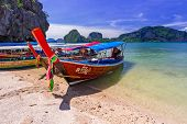 PHANG NGA BAY, THAILAND - 8 NOV 2012: Long tail boats on the coast of James Bond Island. This is the