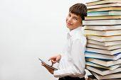 a teenage boy reading an e-book