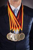 Businessman Wearing Gold Medals