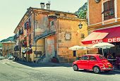 TENDE, FRANCE - AUGUST 12, 2014: Red Volkswagen beetle on the street of Tende - small town in French