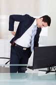 Businessman Suffering From Backache In Office