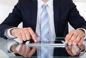 Businessman Using Digital Tablet At Desk