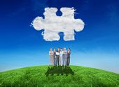 Business team looking at camera against cloud jigsaw piece