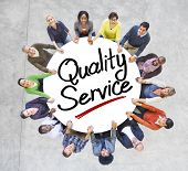 Group of People Holding Hands Around Quality Service