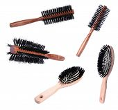 Collage of wooden hairbrushes isolated on white