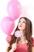 cute young woman dressed as a doll holding pink balloons
