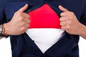 Young Sport Fan Opening His Shirt And Showing The Flag Of Monaco Principality, Monacan Flag