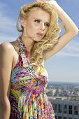 portrait of beautiful young adult sensuality and attractive blonde girl on background blue sky