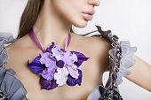 Fashion Studio Shot Of Beautiful Woman With A Big Floral Necklace Around Her Neck (jewelery Made Of