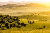 Mountains and grassland at sunset
