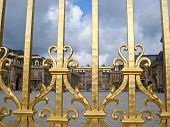 stock photo of versaille  - The golden fence with Versailles Palace on the background - JPG