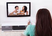 Woman Watching Tv In Living Room