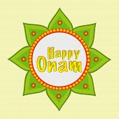 Beautiful rangoli decorated with green betel leaves and stylish text Happy Onam.
