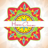 Colorful floral design decorated rangoli on grungy brown background for South Indian festival Happy