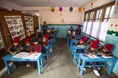 KATHMANDU, NEPAL - DEC 24, 2013: Unknown pupils in English class at primary school. Only 50% of  chi
