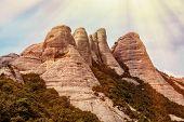 Montserrat mountain summer landscape. Sunshine and soft red tint effect.
