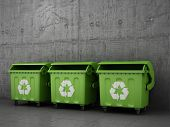 stock photo of dustbin  - Trash can three dustbins outside concrete wall - JPG