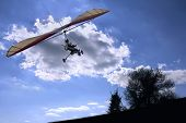 motorized hang glider flying to the sun